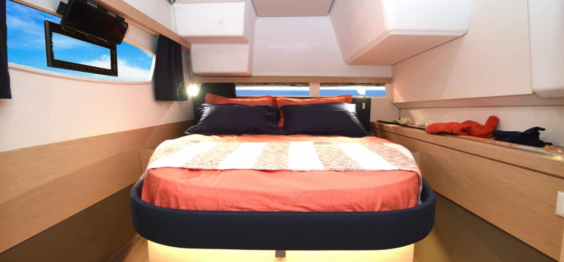The owners cabin in the Fountaine Pajot Lucia 40 looking really inviting with red bed sheets and black pillows