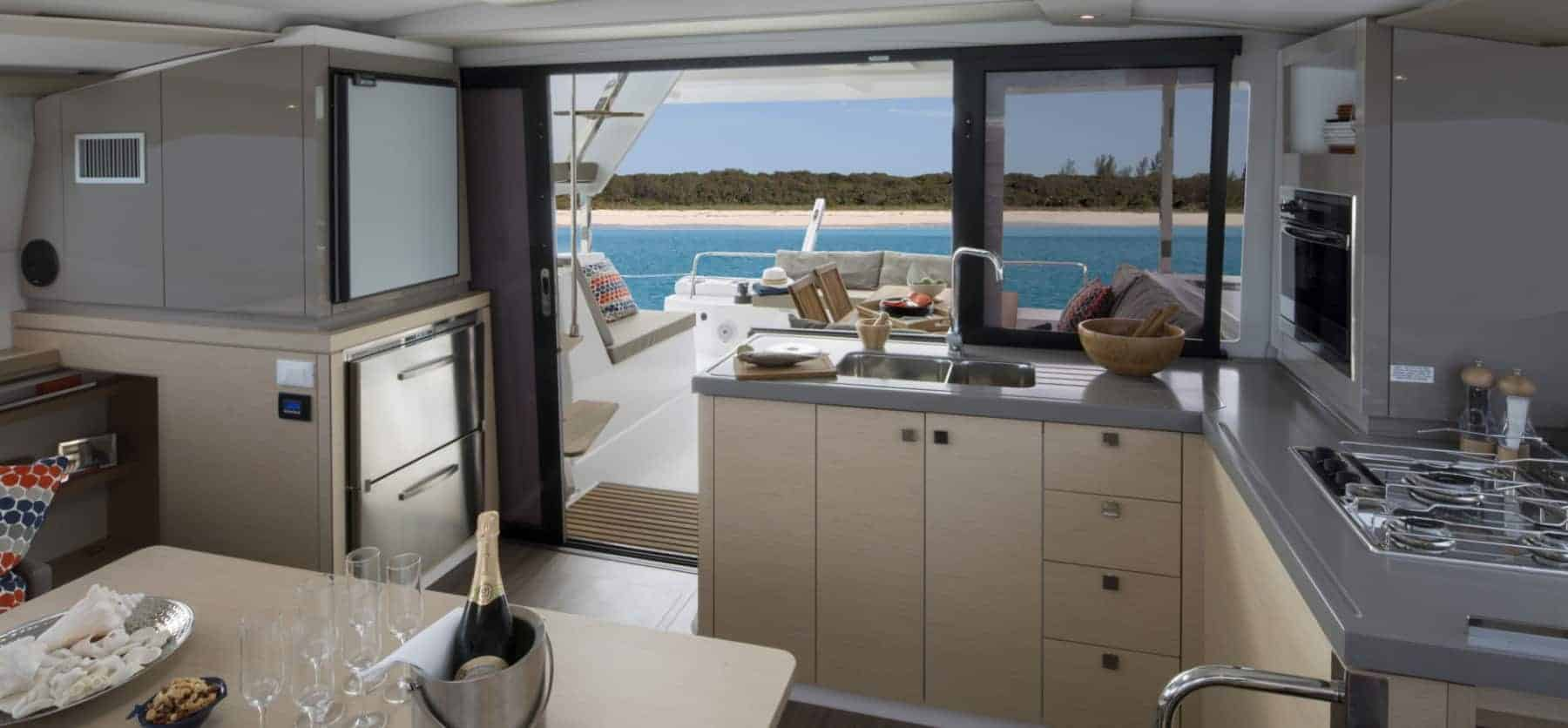 The smart designed galley of Fountaine Pajot Lucia 40 with the beach in the background