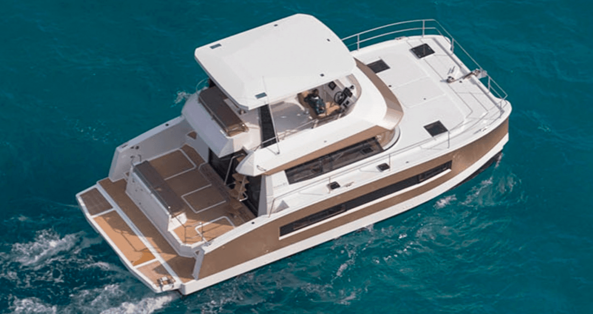 Man relaxing while crusing through the waves with the Fountaine Pajot Motor Yacht 37