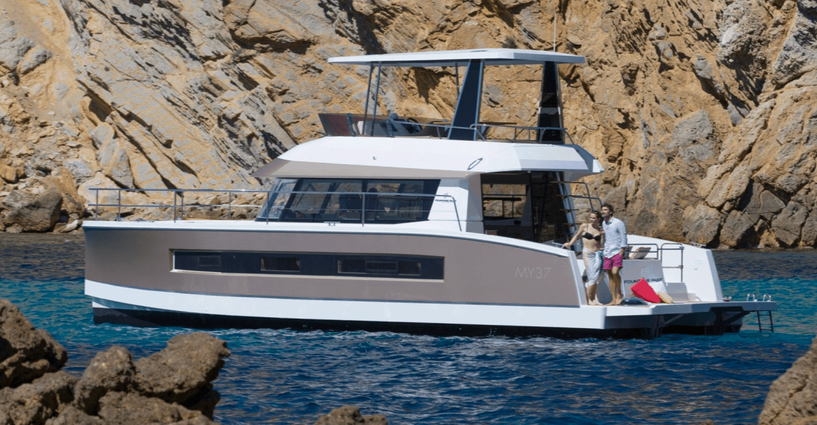 Couple enjoying the view from their Fountaine Pajot Motor Yacht 37