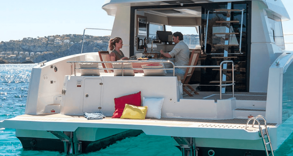 Couple eating dinner at the spacious cockpit of the Fountaine Pajot Motor Yacht 37