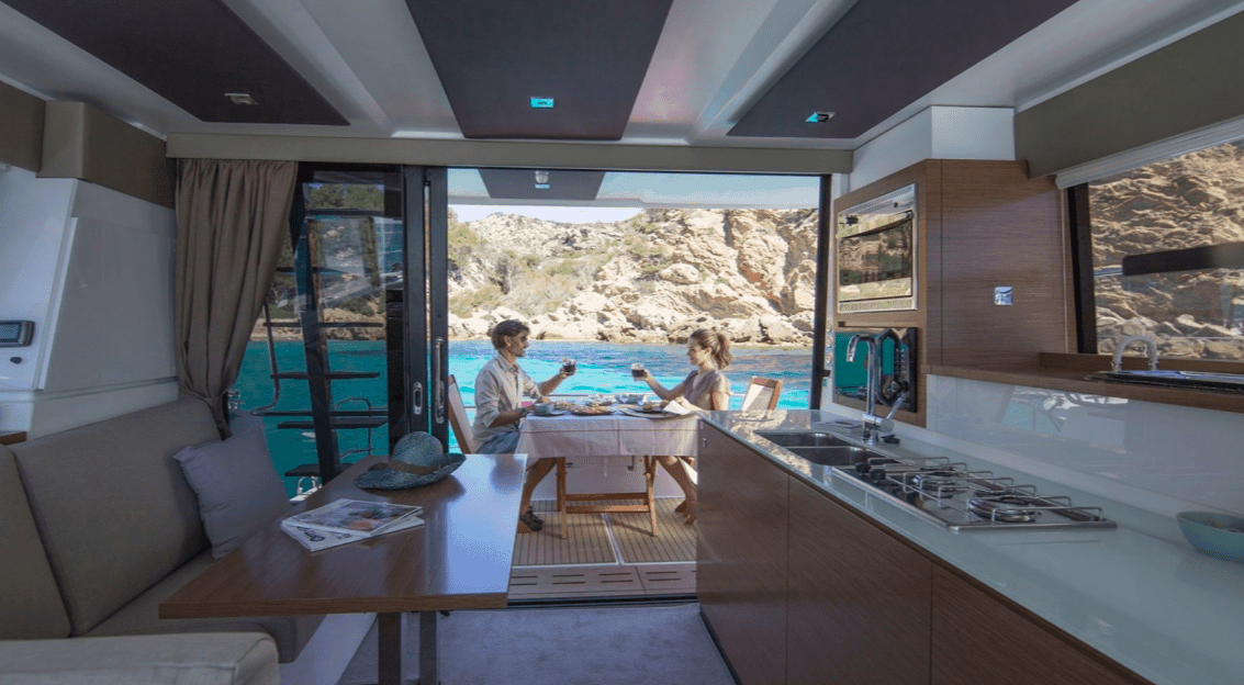 Couple eating dinner at the cockpit of the Fountaine Pajot Motor Yacht 37