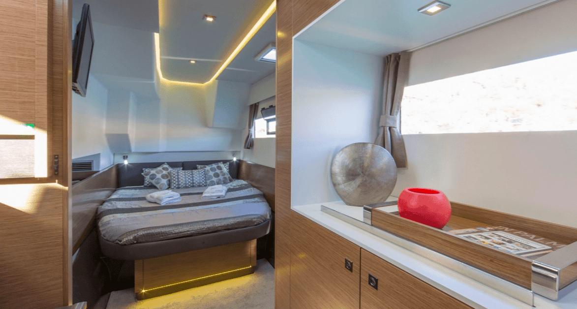 The spacious owners cabin with double bed and storage counter of the Fountaine Pajot Motor Yacht 37