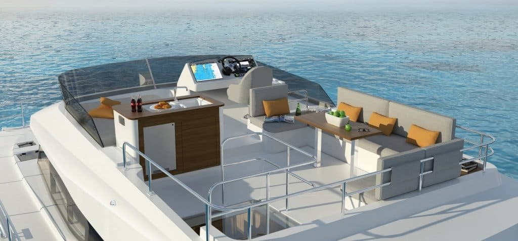 The roomy flybridge on a Fountaine Pajot Motor yacht 40 with a nice sofa, sink and navigation area on it