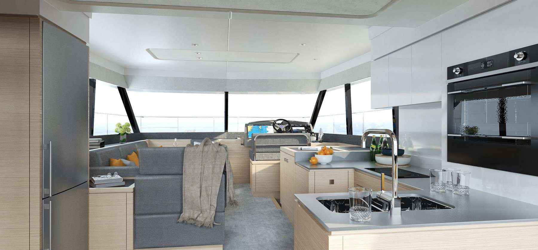 Galley and saloon of a Fountaine Pajot Motor yacht 40 indicates a really comfortable holiday