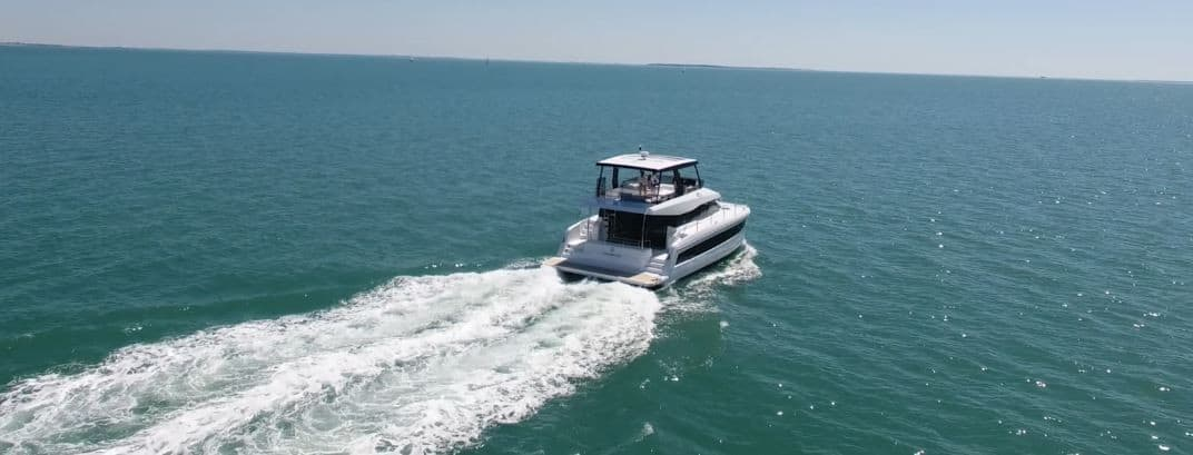 Fountaine Pajot MY 44 from behind cruising through the still waters a sunny day