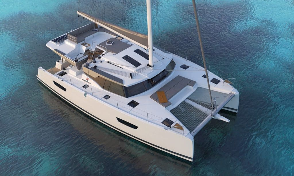 Aerial view of the gracious Fountaine Pajot New 45 floating in clear blue water