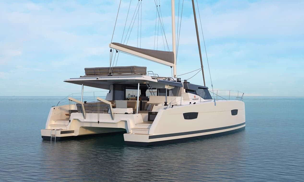 The beautiful Fountaine Pajot New 45 from behind floating in still blue water a sunny day