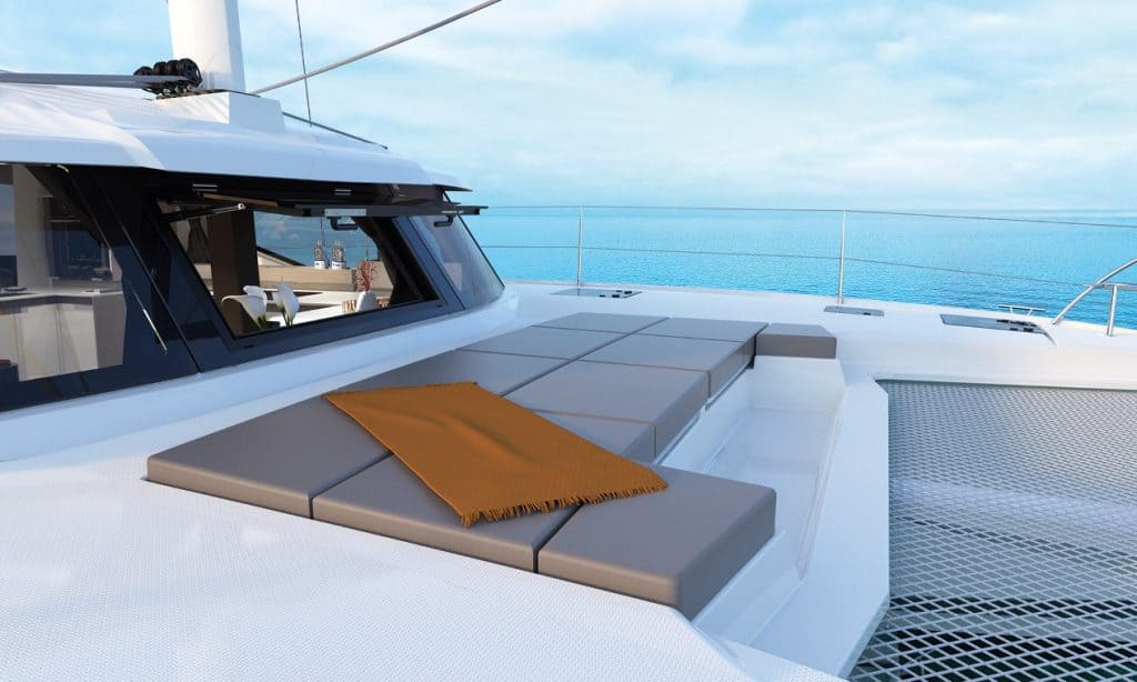 Front deck of the spacious Fountaine Pajot New 45 with mattresses to relax on in front of the cockpit