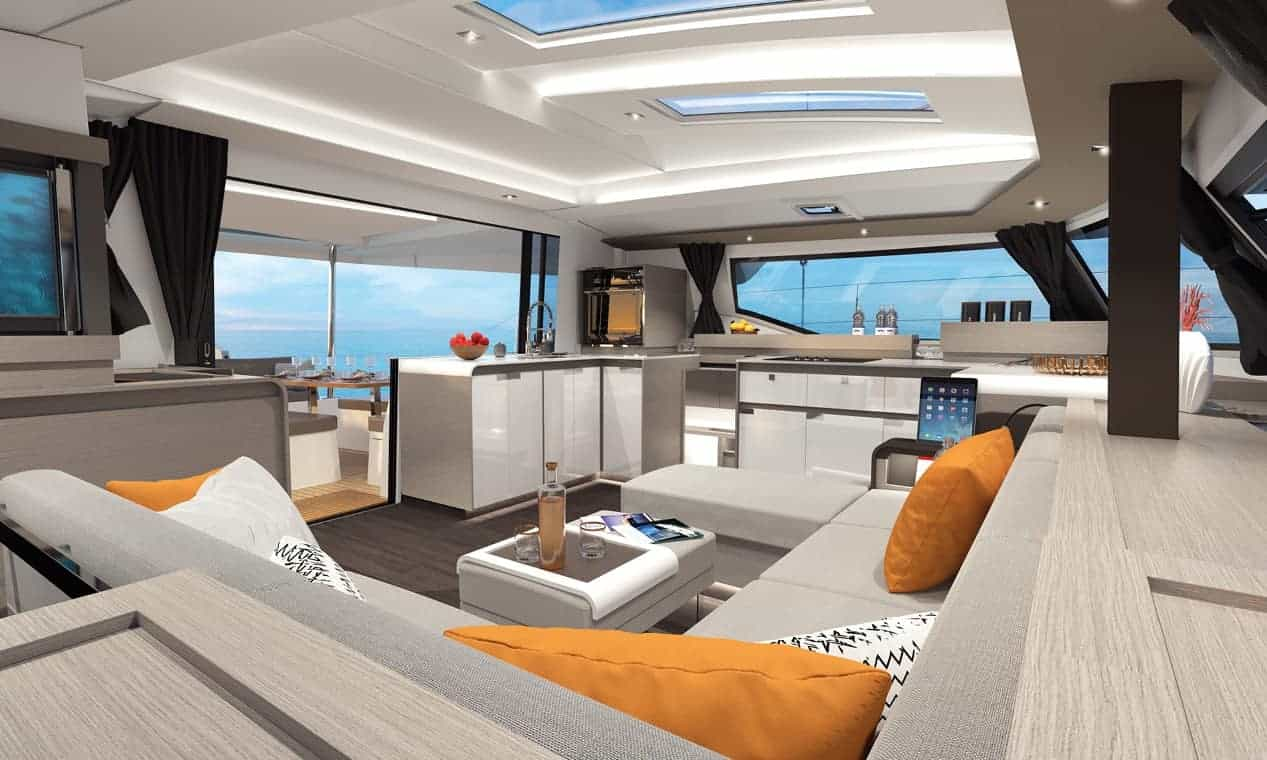 The gorgeous saloon of the Fountaine Pajot New 45 with a great, big sofa in it with modern design with orange details