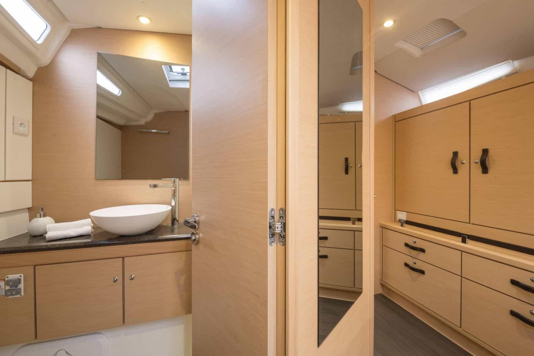 Jeanneau-54-interior-head-2-charter-ownership-yacht