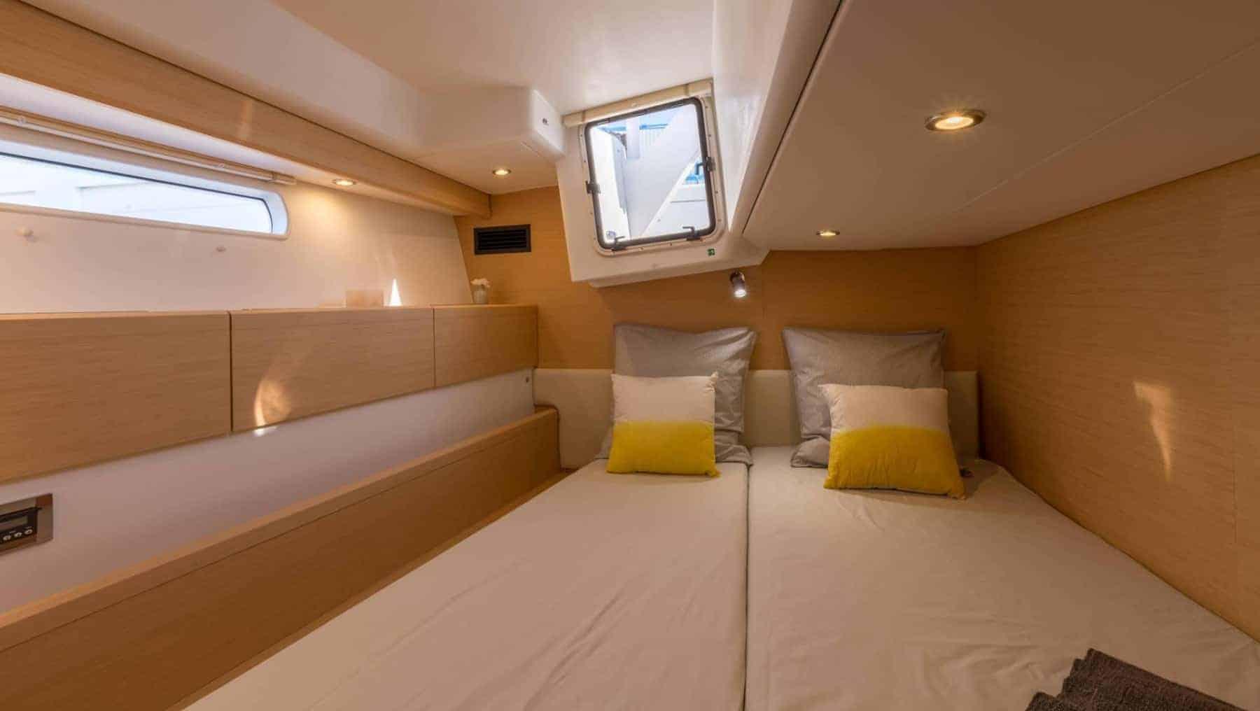 Jeanneau-58-interior-cabin-4-charter-ownership-yacht