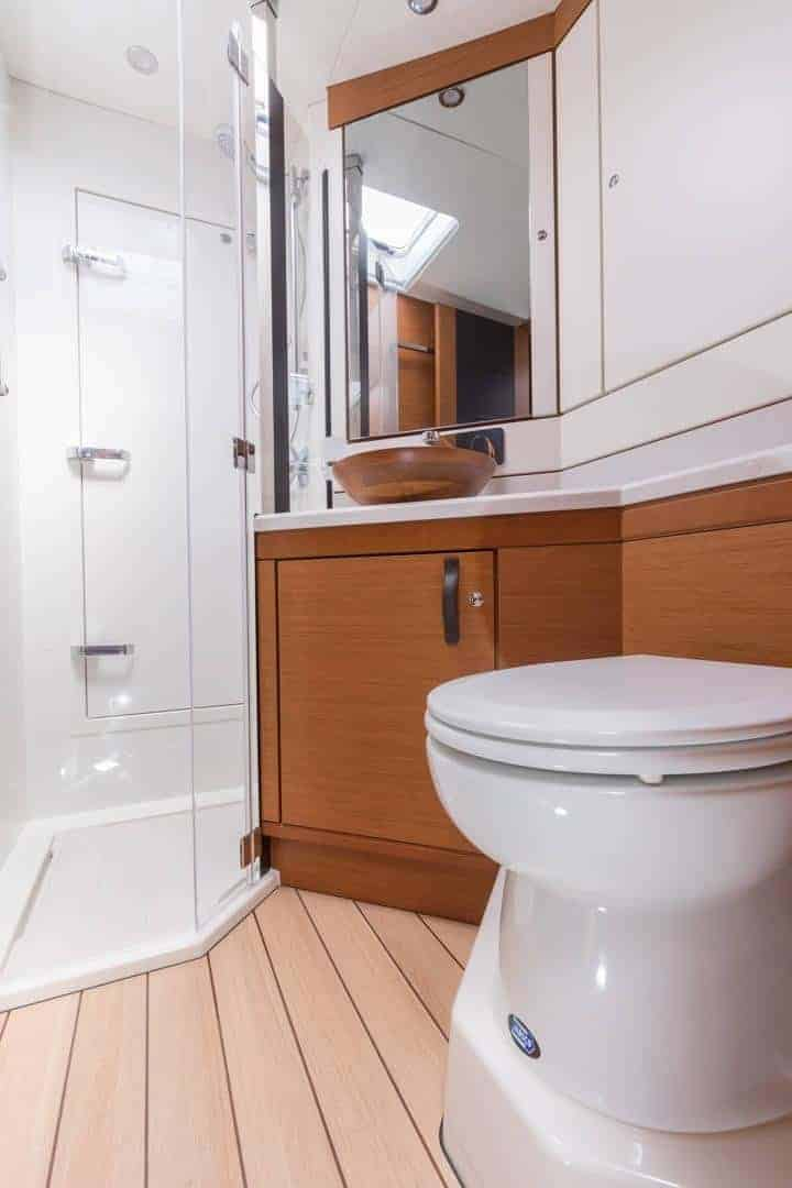 Jeanneau-64-interior-head-1-charter-ownership-yacht