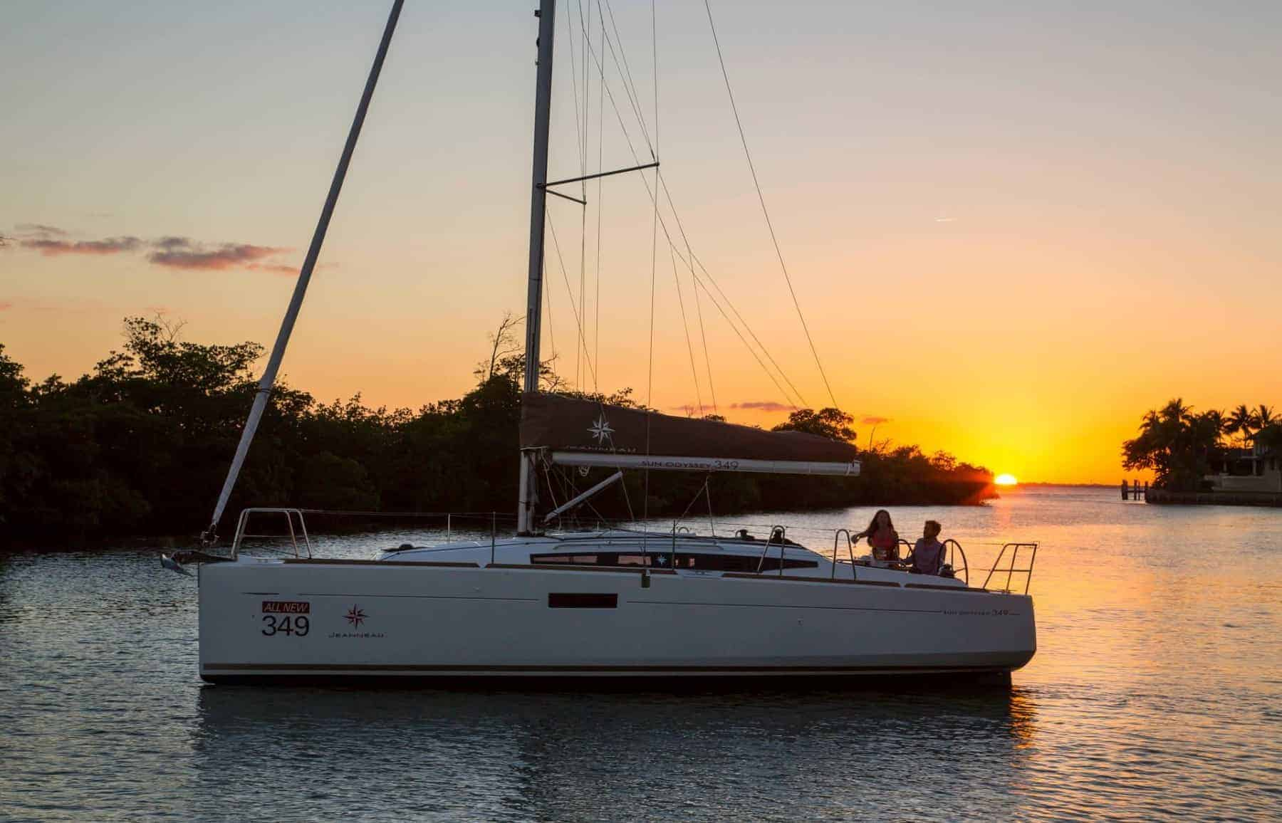 Anchored Jeanneau Sun Odyssey 349 with a beautiful sunset in the background