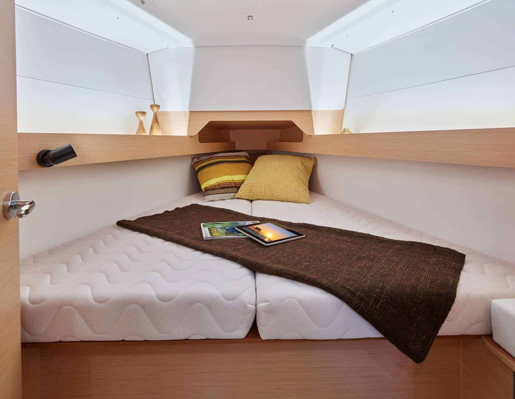 Jeanneau Sun Odyssey 349's owners cabin with a made bed