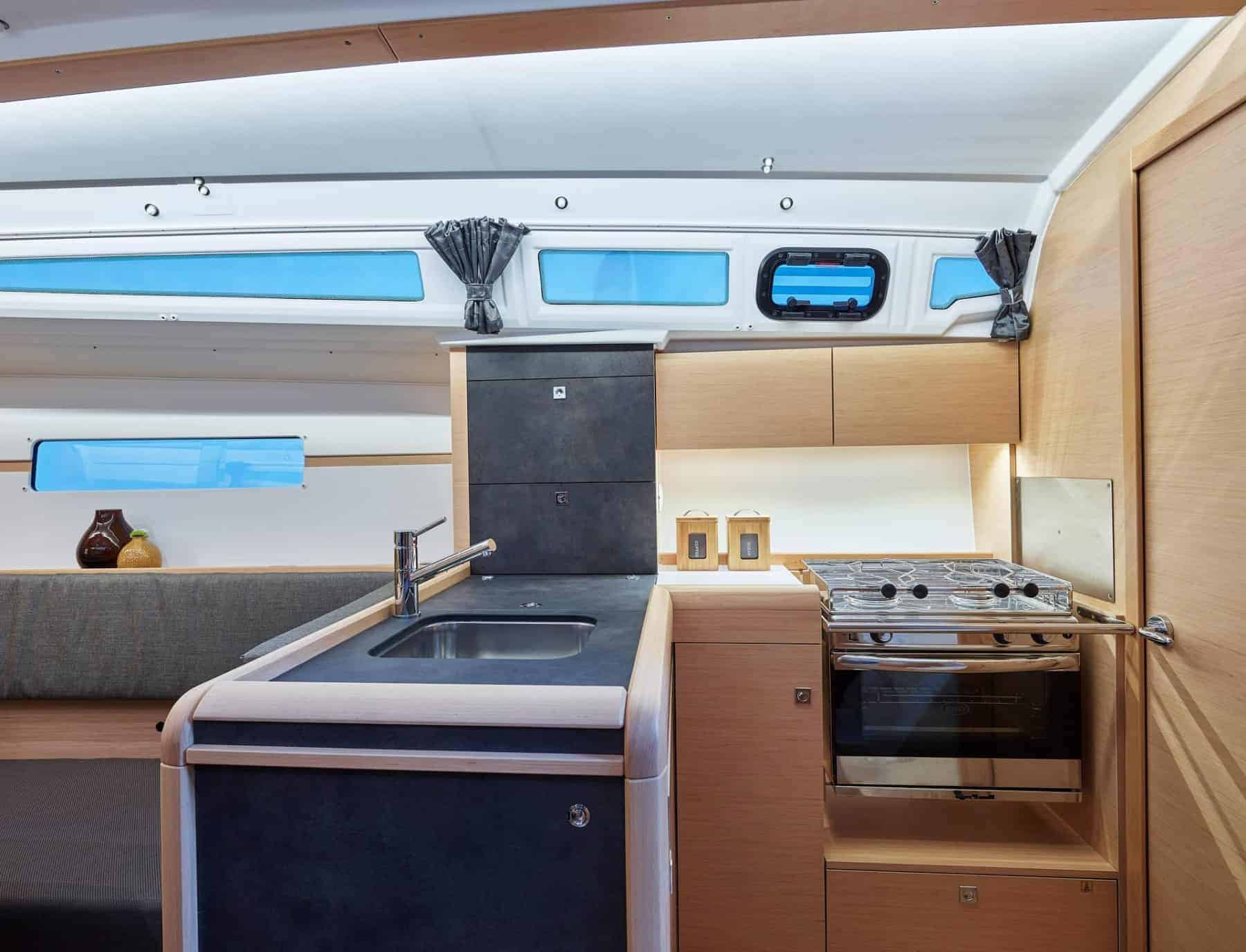 The neat galley of a Jeanneau Sun Odyssey 349