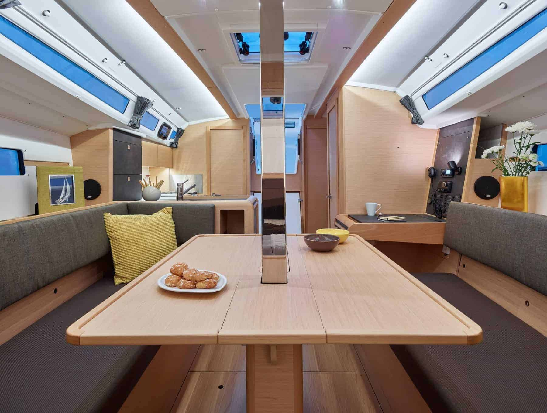 Dinner table in the light and spacious saloon of the Jeanneau Sun Odyssey 349