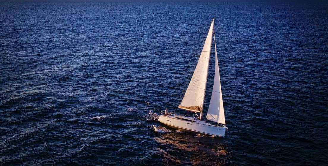 Jeanneau Sun Odyssey 389 sailing calmly on the ocean with its sail out