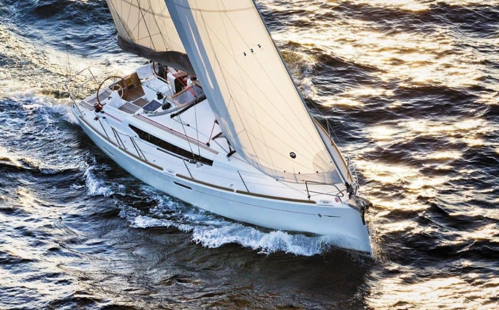 Jeanneau Sun Odyssey 389 from above with wind in its sails