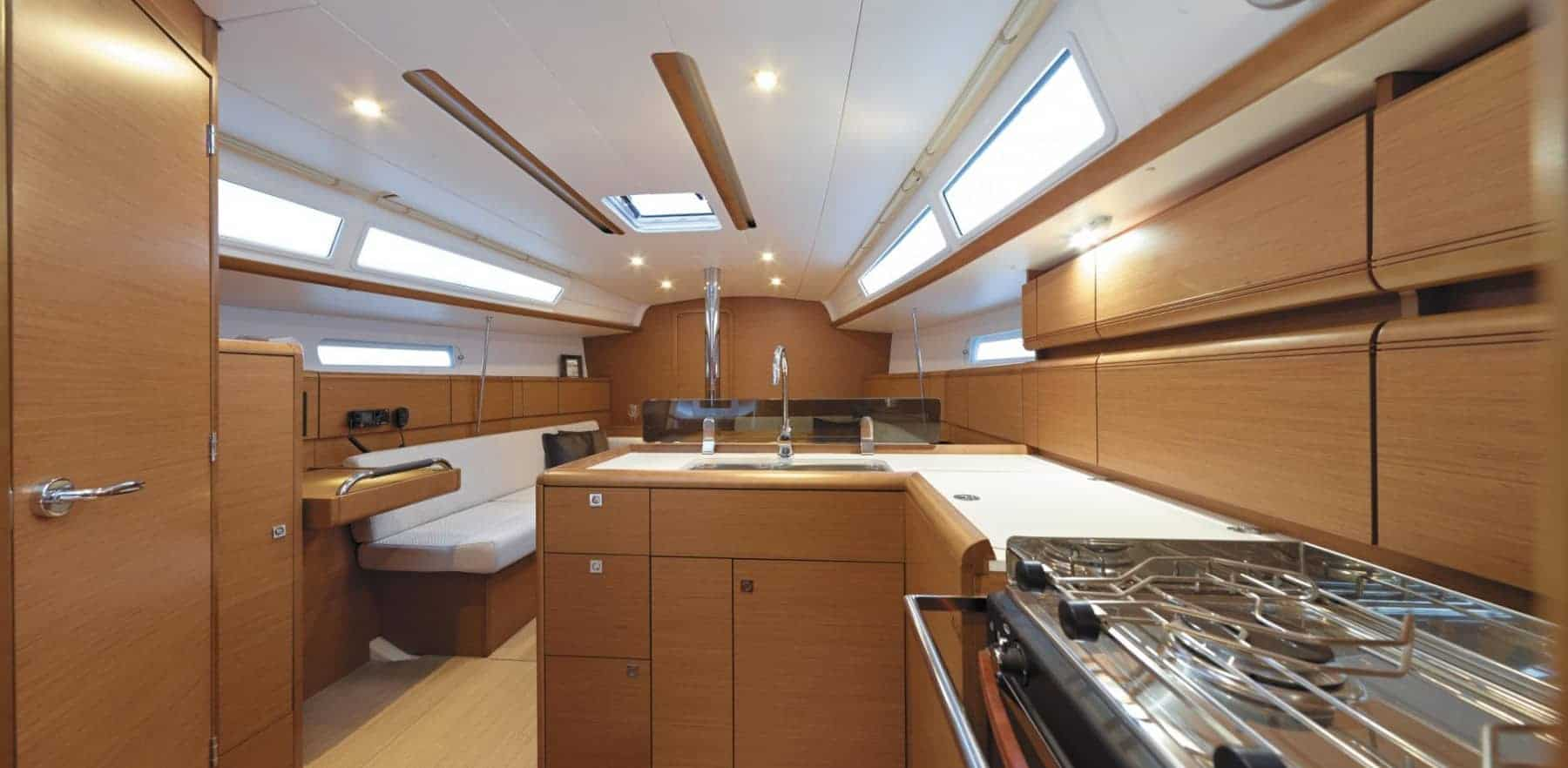 View from the galley showing the whole hull and saloon of the beautiful Jeanneau Sun Odyssey 389
