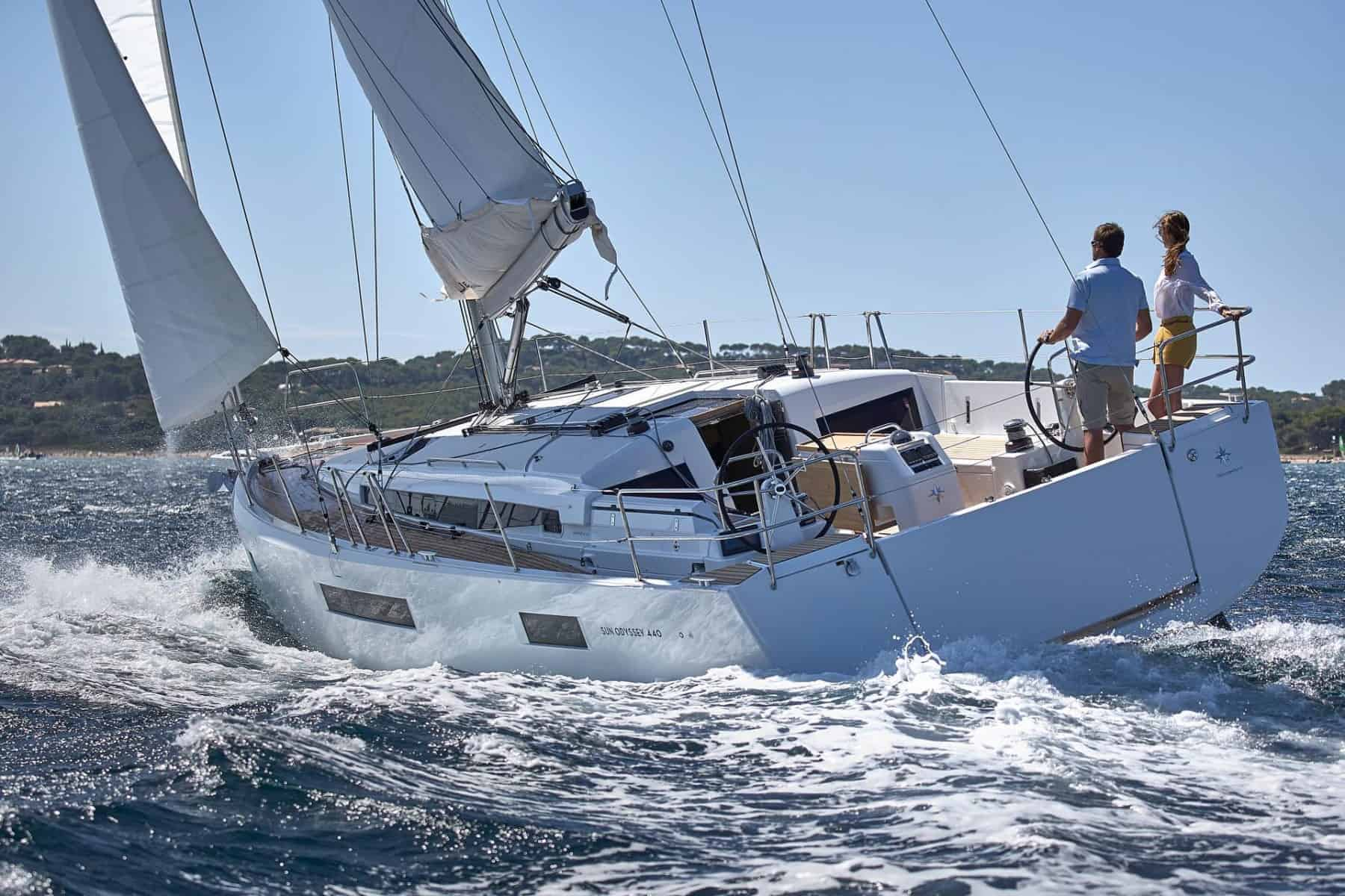 Jeanneau Sun Odyssey 440 from behind with wind in its sail a sunny day