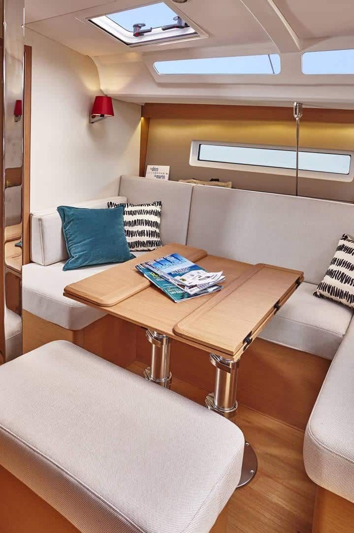 Dinner table in the Jeanneau Sun Odyssey 440 with smart foldable functionality