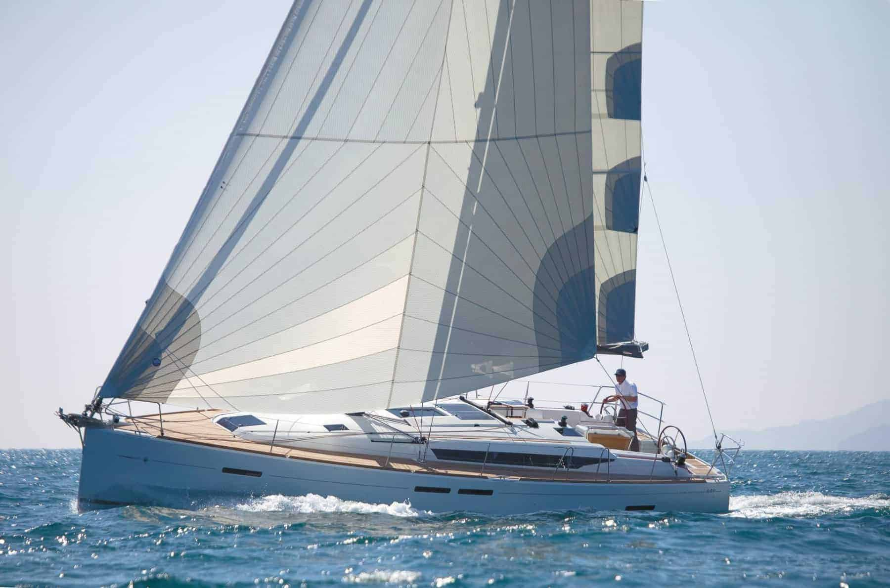 Jeanneau Sun Odyssey 449 in action a sunny day with a man at the steering wheel