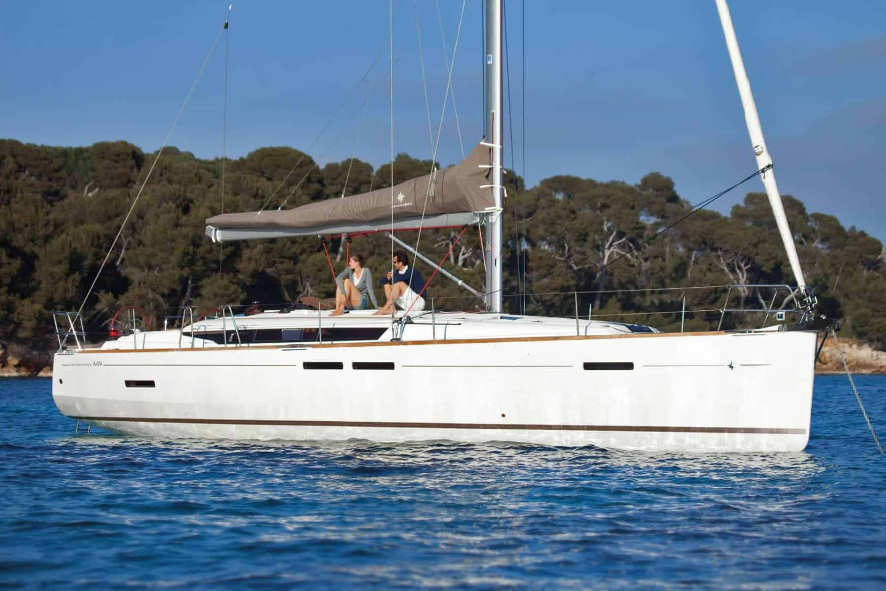 Floating Jeanneau Sun Odyssey 449 with a man and a woman relaxing on the deck