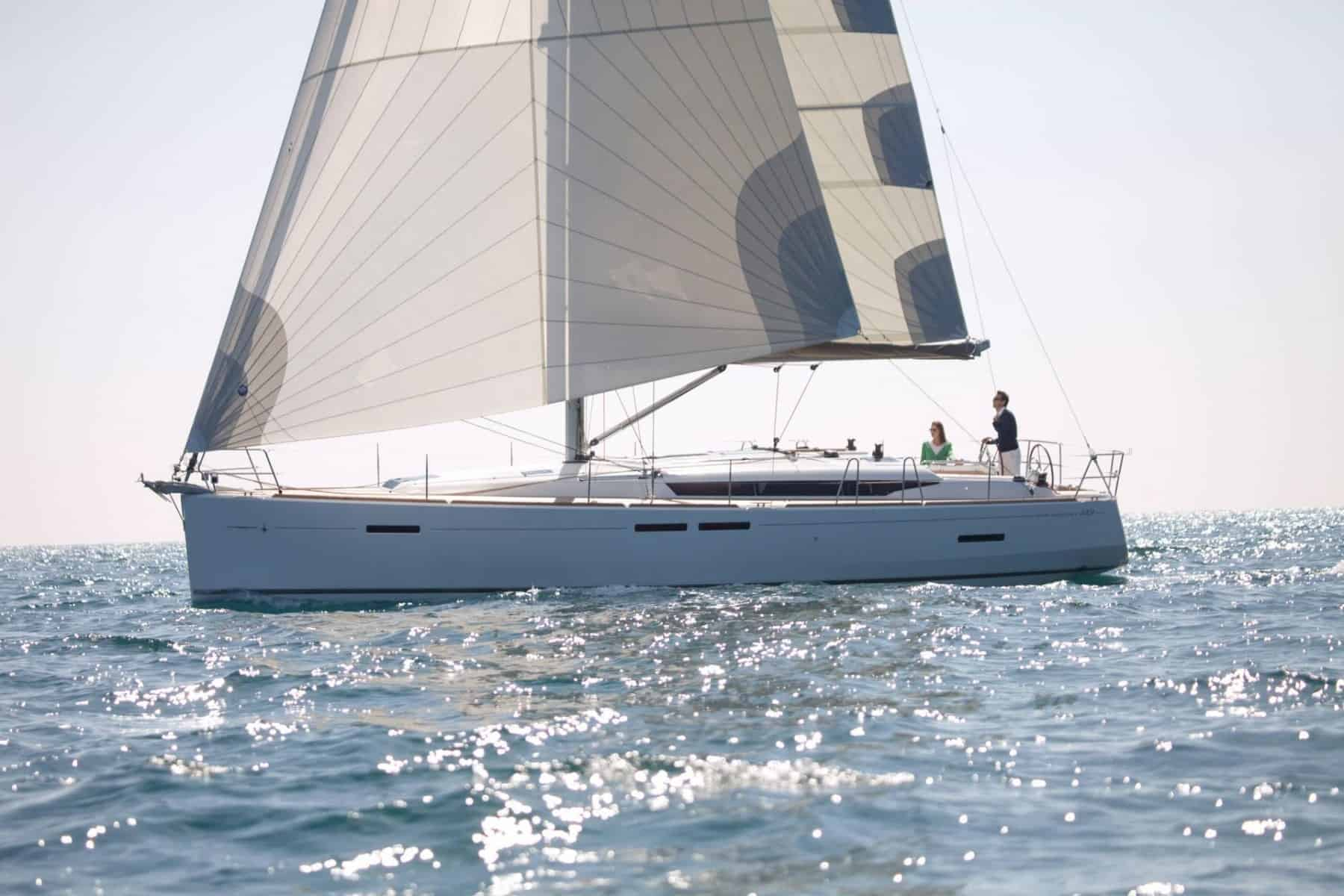 Jeanneau Sun Odyssey 449 in profile sailing with wind in its sail