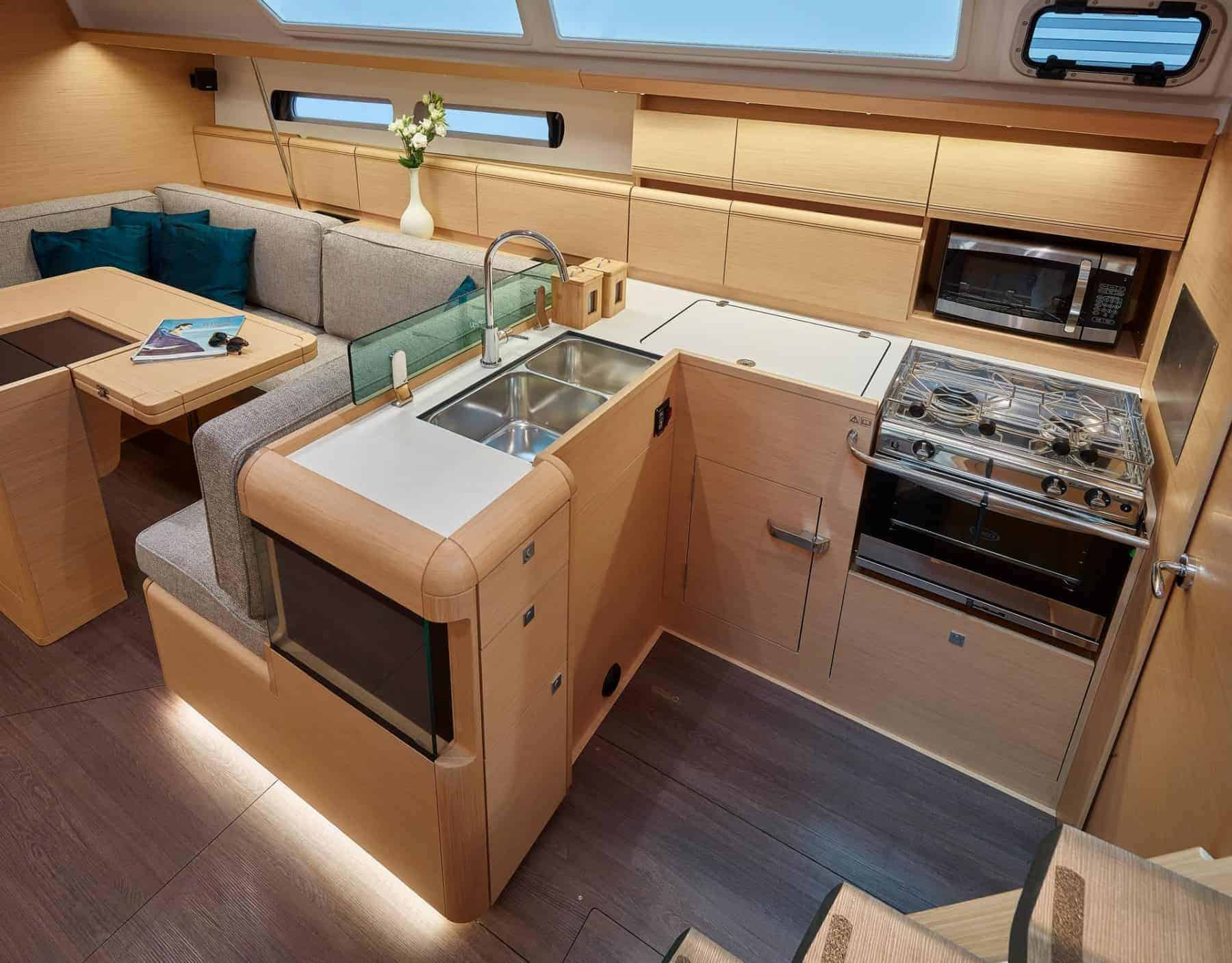 Galley of Jeanneau Sun Odyssey 449 with stove, sink and microwave oven