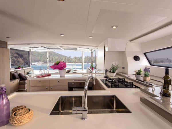 The elegant galley of a Bali 5.4 yacht with a beautiful beach in the background