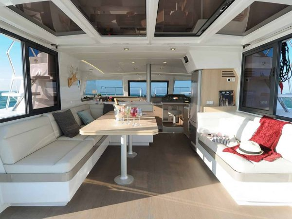 Deck of the bali 4.1 with great looking white sofas and a set table