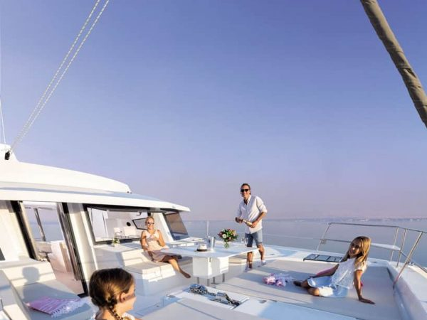 Family of four having a good time on the broad deck of the Bali 5.4