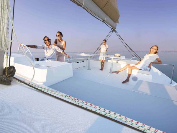 The big, white flybridge of BALI 5.4 with a family of four enjoying themselves on it