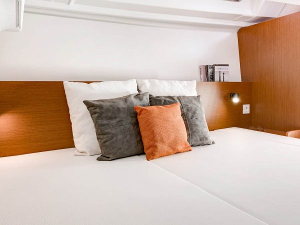 Beautiful made bed with nice pillows in the cabin of a Beneteau Oceanis 35.1