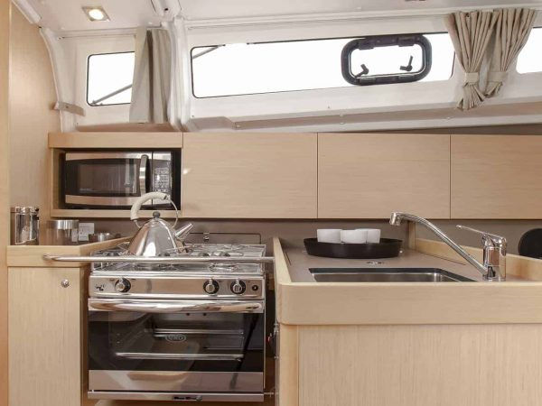 The galley of the Beneteau Oceanis 35.1 looking elegant and home feeling