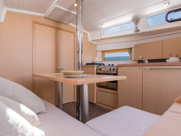 Beautiful and minimalistic saloon and kitchen area of the Beneteau Oceanis 38.1