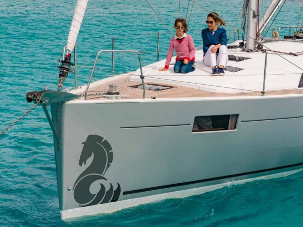 Mother and daughter relaxing on the massive front deck of the Beneteau Oceanis 44.1