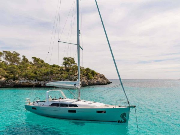 The beautiful and luxurious Benteteau Oceanis 44.1 anchored along side a beauful coastline