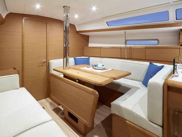 Smart dinner table in the saloon of Jeanneau Sun Odyssey 389 that is adjustable
