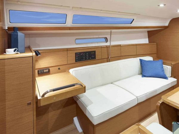 White couch to relax in in the elegant saloon of a Jeanneau Sun Odyssey 389