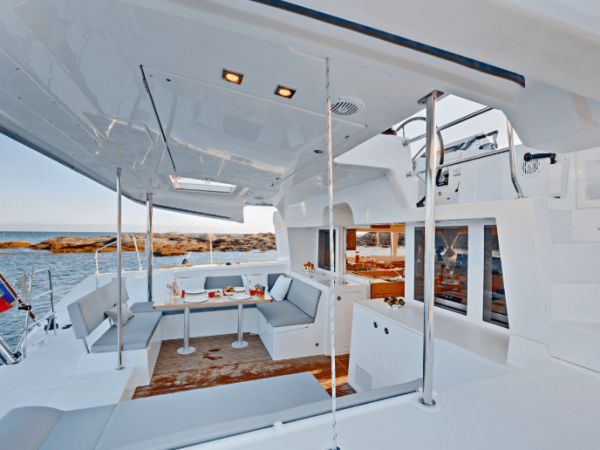 Deck of the Lagoon 450 F with wet wooden floor from people coming up from a swim in the water