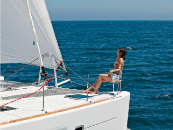 Woman chilling at the deck of the Lagoon 450 F while it sails