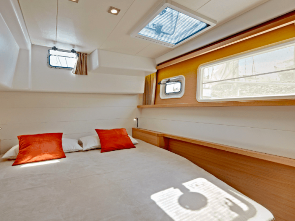 The light cabin in Lagoon 450 with many windows and soothing interior