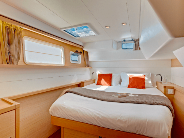 A queen size bed in the soothing cabin of the Lagoon 450 F