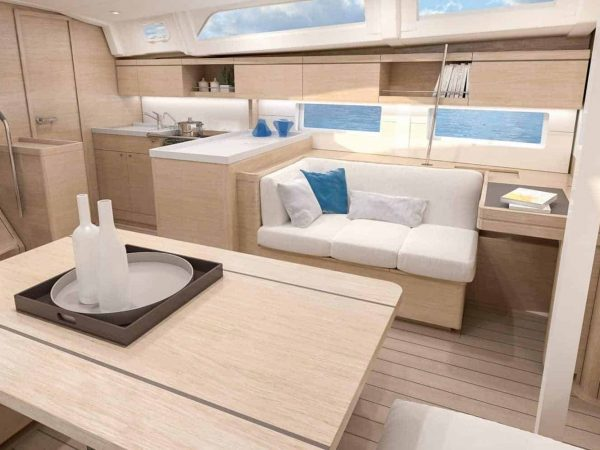 Luxurious and minimalistic atmosphere of the interior galley and dining area of the Beneteau Oceanis 46.1